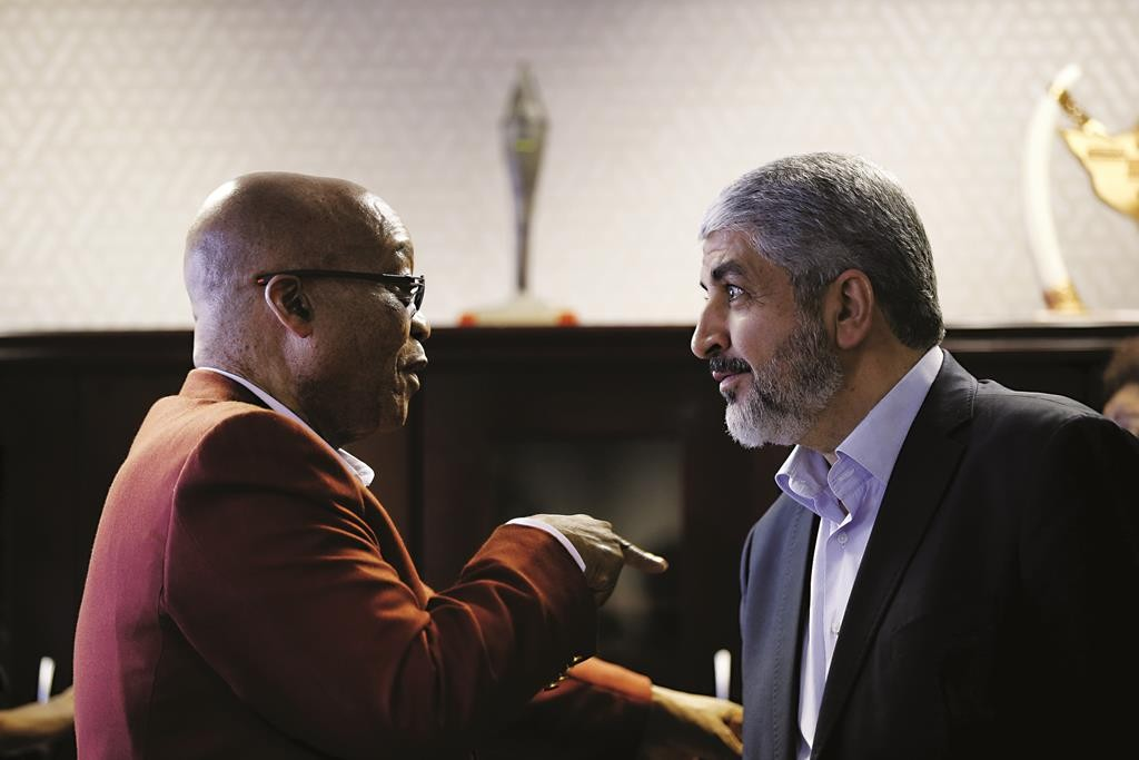 Hamas chief Khaled Meshaal (R) speaking with South African President Jacob Zuma ahead of a media briefing at the headquarters of South Africa's ruling African National Congress (ANC) in Johannesburg, Monday.  (REUTERS/Siphiwe Sibeko)