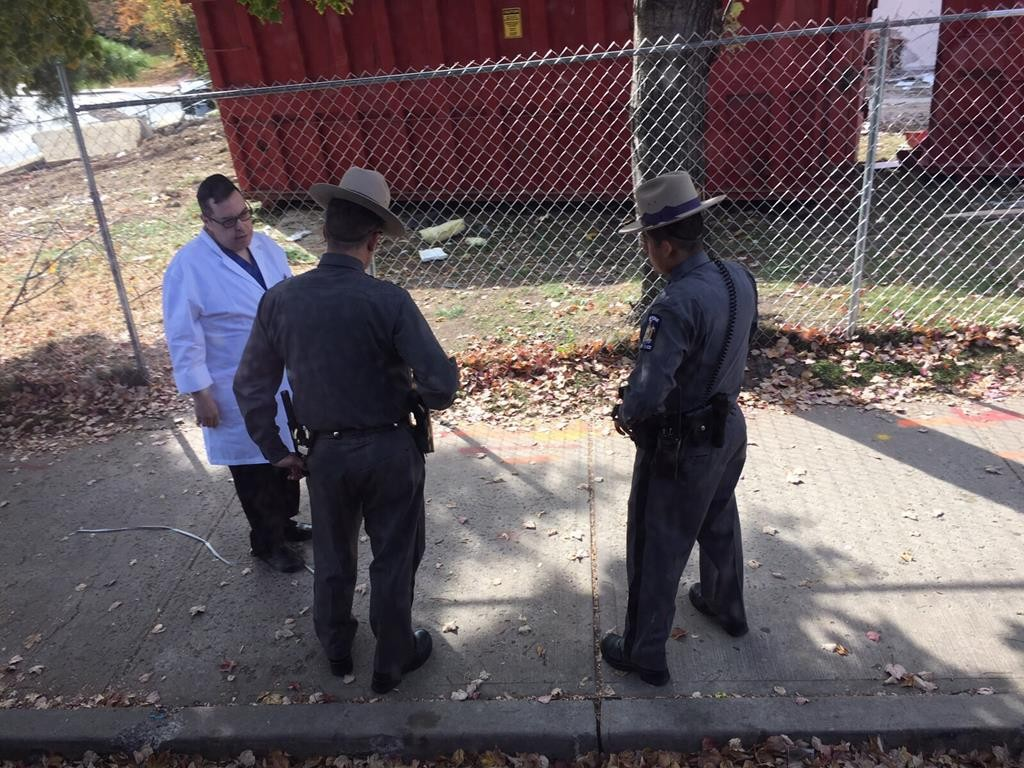State Police investigators on Thursday probe the site where a Jewish man reported being shot at the night before with a pellet gun at Satmar Drive in Kiryas Joel, N.Y. (JPUpdates.com)