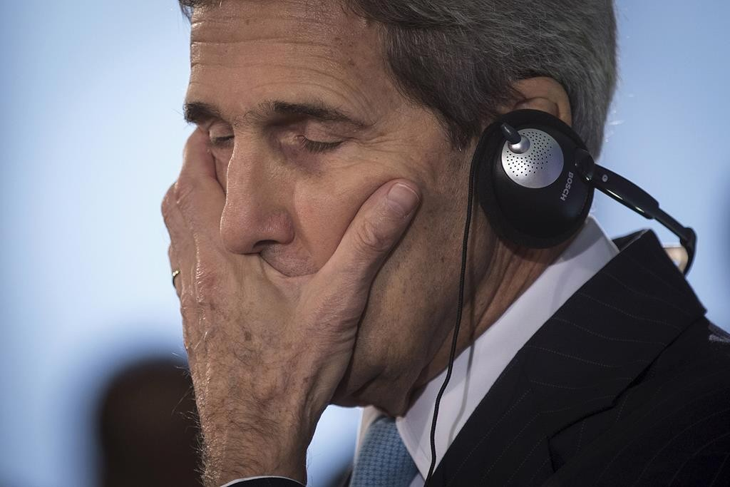 Secretary of State John Kerry reacts during a press briefing with Germany's Foreign Minister Frank-Walter Steinmeier in Berlin, Thursday, where he also met Israeli Prime Minister Binyamin Netanyahu. (Reuters/Carlo Allegri)