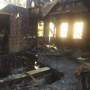 Smoke and flames rise on Friday, at Poile Zedek.  (AP Photo/Mel Evans – WABC via AP)