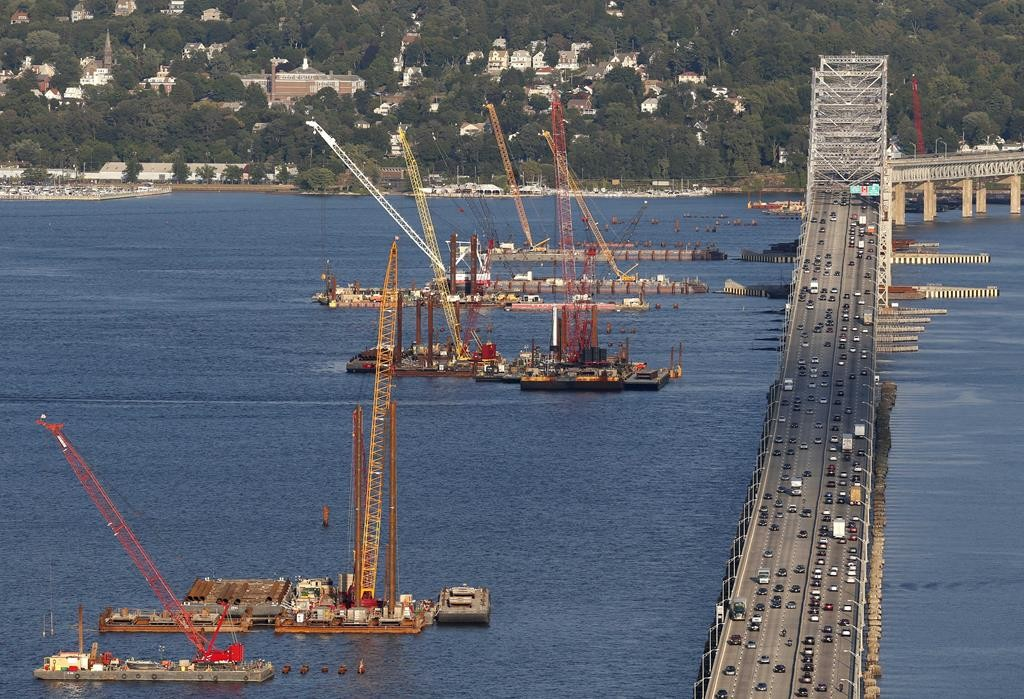 Construction cranes work on the foundations for a new Tappan Zee Bridge. (AP Photo/Seth Wenig)