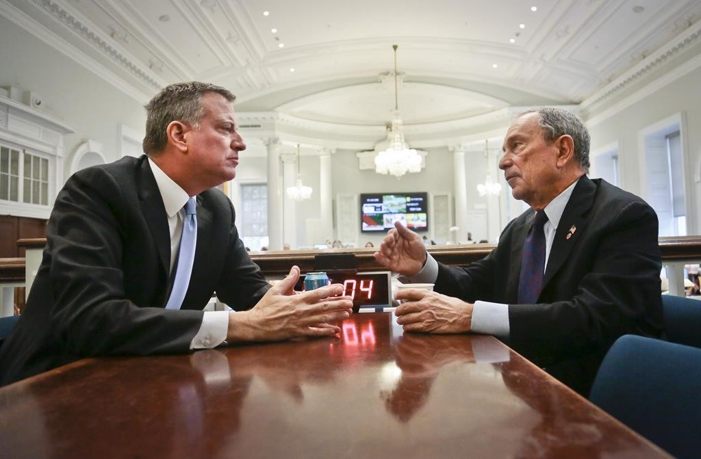 Then-Mayor Michael Bloomberg meets Mayor-elect Bill de Blasio (L) at City Hall the day after de Blasio's election victory, which was largely by slamming Bloomberg's record. The two are planning on making up next week. (AP Photo/Bebeto Matthews)