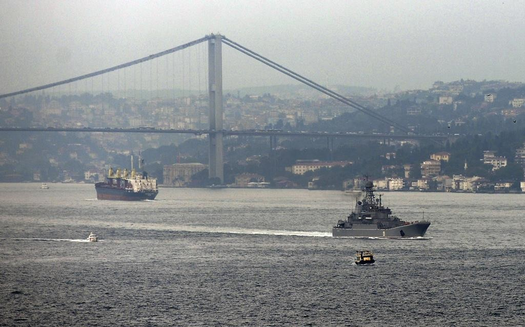 A Russian warship passes through the Bosphorus, in Istanbul, en route to the Mediterranean Sea, Tuesday. Russia began launching military operations in Syria on Wednesday, targeting mainly central and northwestern Syria, strategic regions that are the gateway to its long-term ally President Bashar Assad's main strongholds.  (AP Photo)