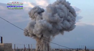 Smoke rising after a Russian airstrike hit buildings in the town of Latamna in the area of Hama in Eastern Syria, Wednesday. (Syrian Revolutionary Command Council in Hama via AP Video)