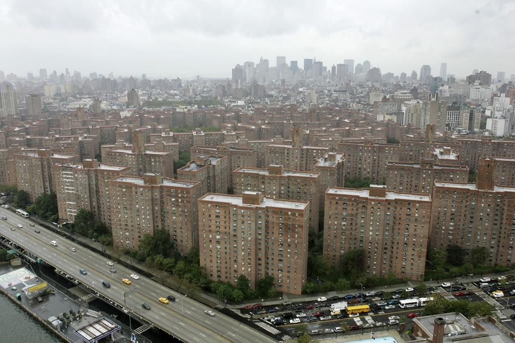 The sale of Peter Cooper Village and Stuyvesant Town apartment complex, an enclave of 110 buildings on the East Side and Manhattan's largest complex, was announced on Tuesday for $5.3 billion. It will preserve nearly half of its 11,232 units for middle-class families. (AP Photo/Mary Altaffer)