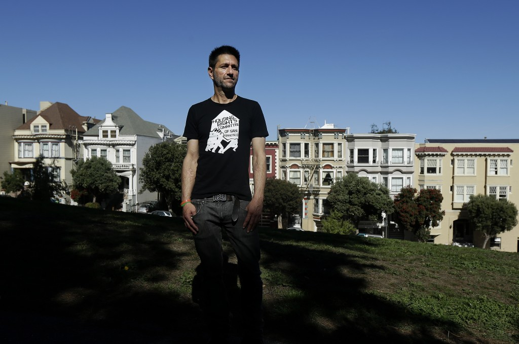 Michael Rouppet across the street from the home he was evicted from in San Francisco. (AP Photo/Jeff Chiu)
