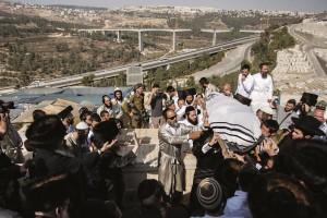 """At the levayah of Aharon Banita, Hy""""d, at Har HaMenuchos cemetery, October 4. (Yonatan Sindel/Flash90)"""