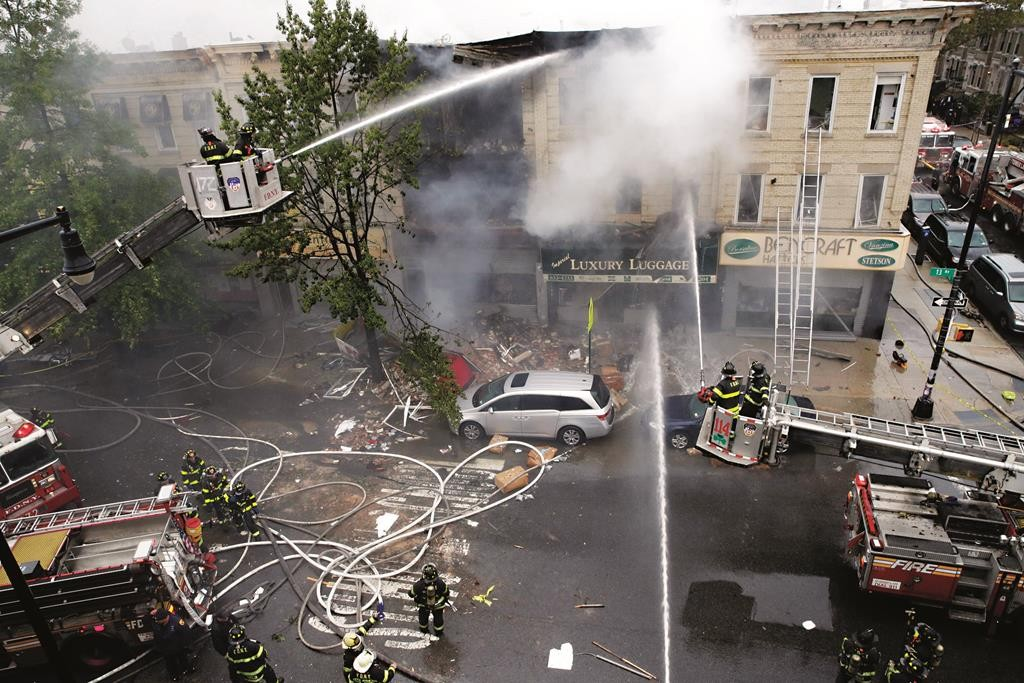 Firefighters work at the scene of an explosion of a three-story building in Boro Park, Oct. 3. (AP Photo/Mary Altaffer)