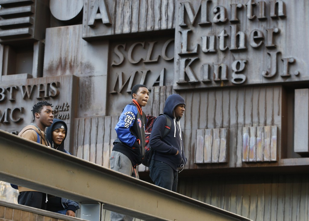 Students congregate on the steps of Martin Luther King Jr. High School on Manhattan's Upper West Side, Tuesday, in New York, before leaving school for the day. Martin Luther King is one of 88 New York City schools requiring students to pass through metal detectors before entering.  (APPhoto/Kathy Willens)
