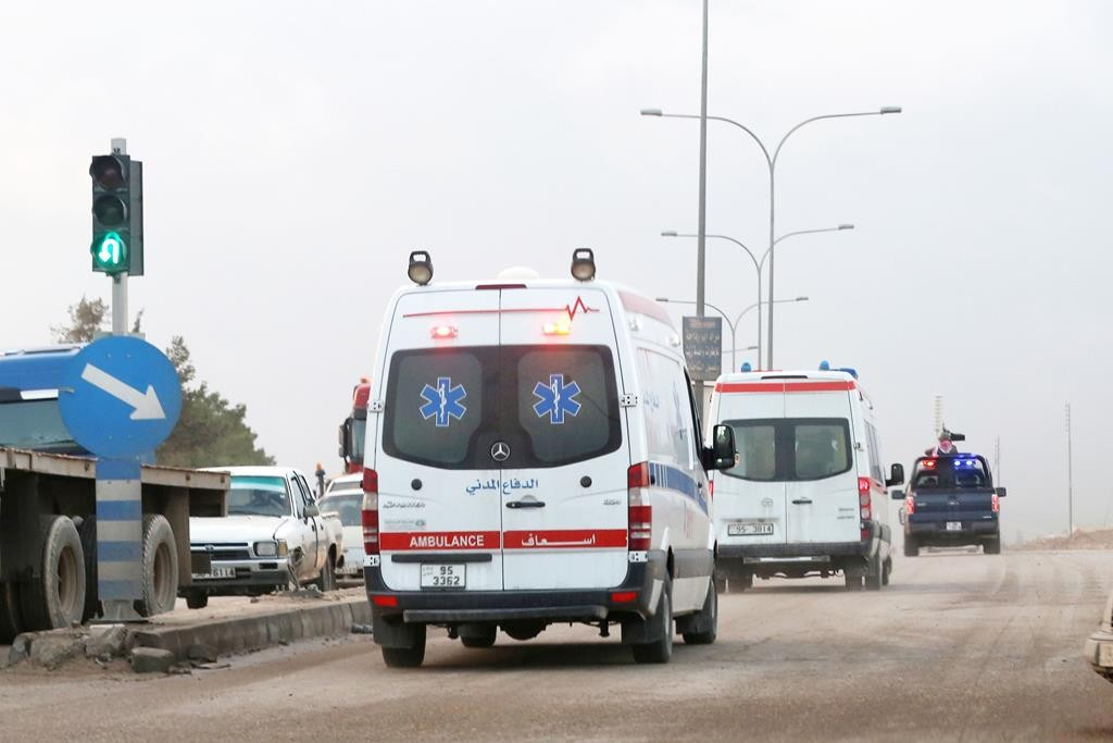 Ambulances leave the King Abdullah bin Al Hussein Training Center where a Jordanian policeman went on a shooting spree in Mwaqar on the outskirts of Amman, Jordan, Monday, Nov. 9, 2015. (AP Photo/Raad Adayleh)