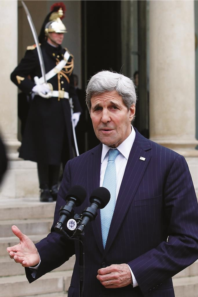 Secretary of State John Kerry delivers a statement at the Elysee Palace after his meeting with French President Francois Hollande in Paris, France, Tuesday. (AP Photo/Francois Mori)