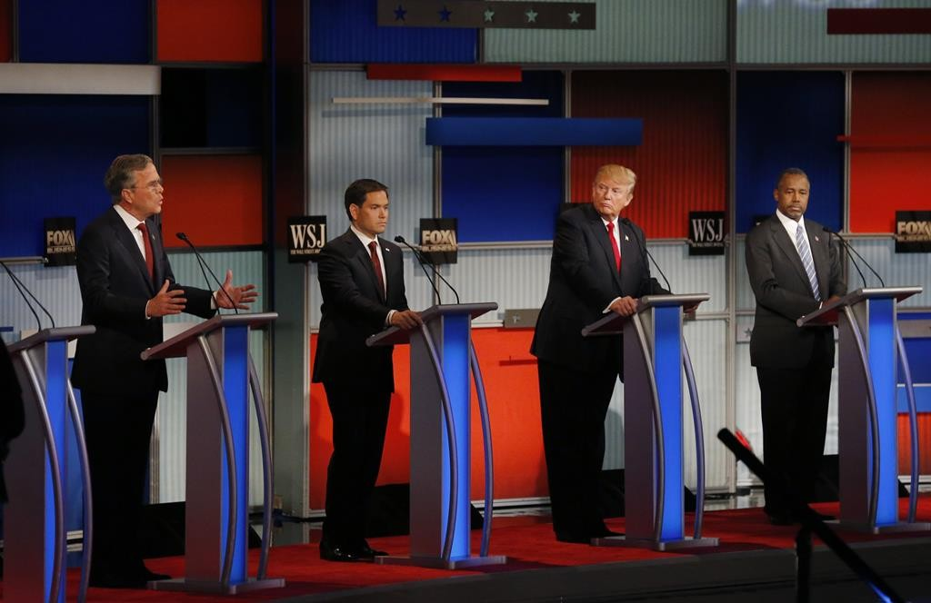 Republican U.S. presidential candidate and former Governor Jeb Bush (L) speaks as U.S. Senator Marco Rubio (2nd L), businessman Donald Trump and Dr. Ben Carson (R) listen during the debate held by Fox Business Network for the top 2016 U.S. Republican presidential candidates in Milwaukee, Wisconsin, November 10.  (REUTERS/Jim Young)
