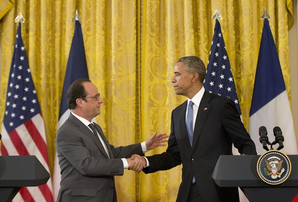 President Barack Obama shakes hands with President Francois Hollande of France during their news conference in the East Room of the White House in Washington, Tuesday. (Martinez Monsivais)