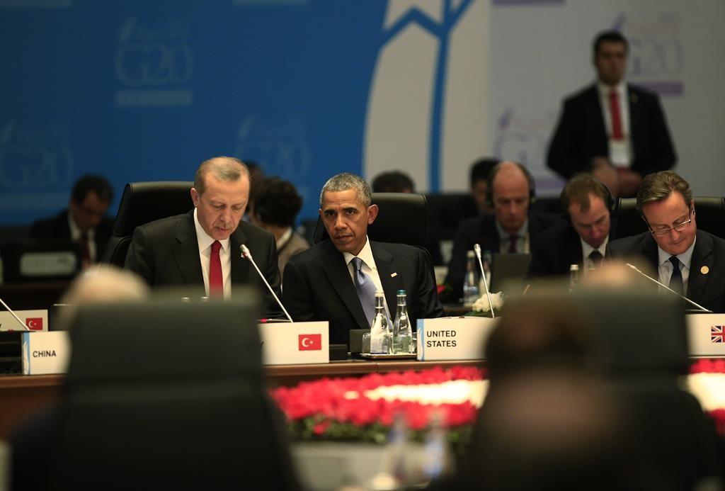 U.S President Barack Obama looks on as Turkish President Recep Tayyip Erdogan (L) presides over a session of the G-20 summit, in Antalya, Turkey, Sunday. The 2015 G-20 Leaders Summit is held near the Turkish Mediterranean coastal city of Antalya on Nov. 15-16, 2015.  (AP Photo/Lefteris Pitarakis)