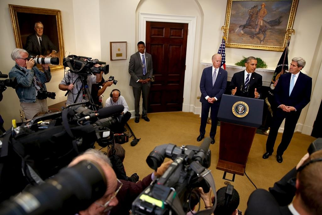 President Barack Obama (2nd R), flanked by Vice President Joe Biden (3rd R) and Secretary of State John Kerry (R), delivers a statement on the Keystone XL pipeline at the White House in Washington on Friday. (REUTERS/Jonathan Ernst)
