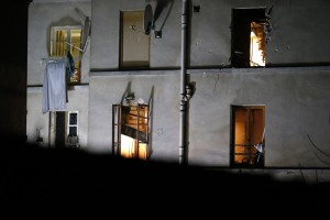 Bullet holes and smashed windows are visible on the back of a house after an intervention of security forces against a group of terrorists in Saint-Denis, near Paris, Wednesday. (AP Photo/Michel Euler)