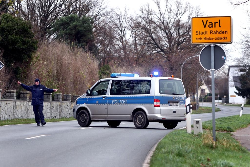 Members of the German police block a street in Varl, Germany, Tuesday. Police in northwestern Germany say they're investigating a tip received from a member of the public that a suspect wanted in theParisattacks may be hiding out in a rural area near Hannover. (Tyler Larkin/dpa via AP)