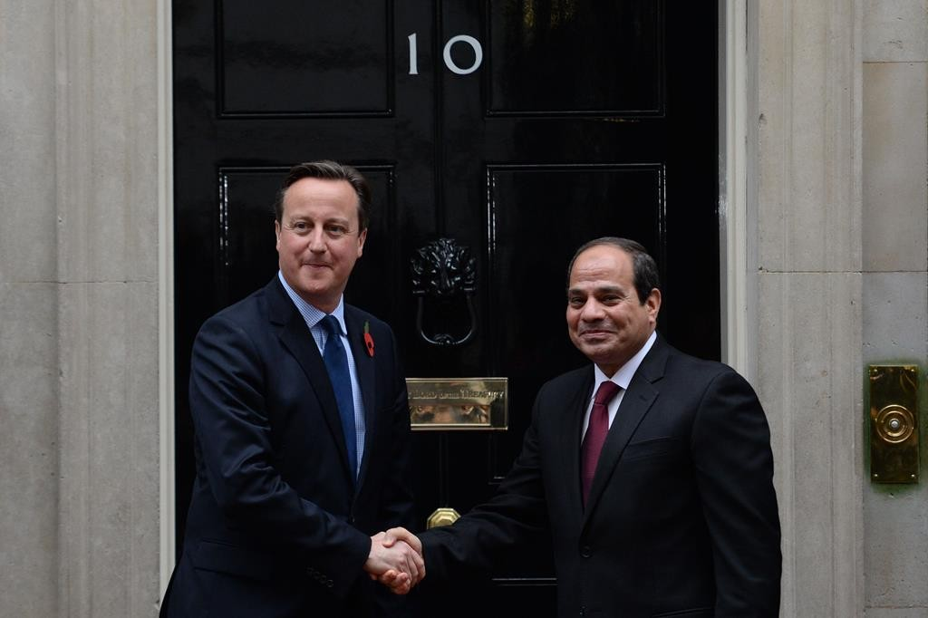 Britain's Prime Minister David Cameron greets Egyptian President Abdel Fatah el-Sisi at 10 Downing Street in London ahead of their meeting Thursday. (Stefan Rousseau/PA via AP)