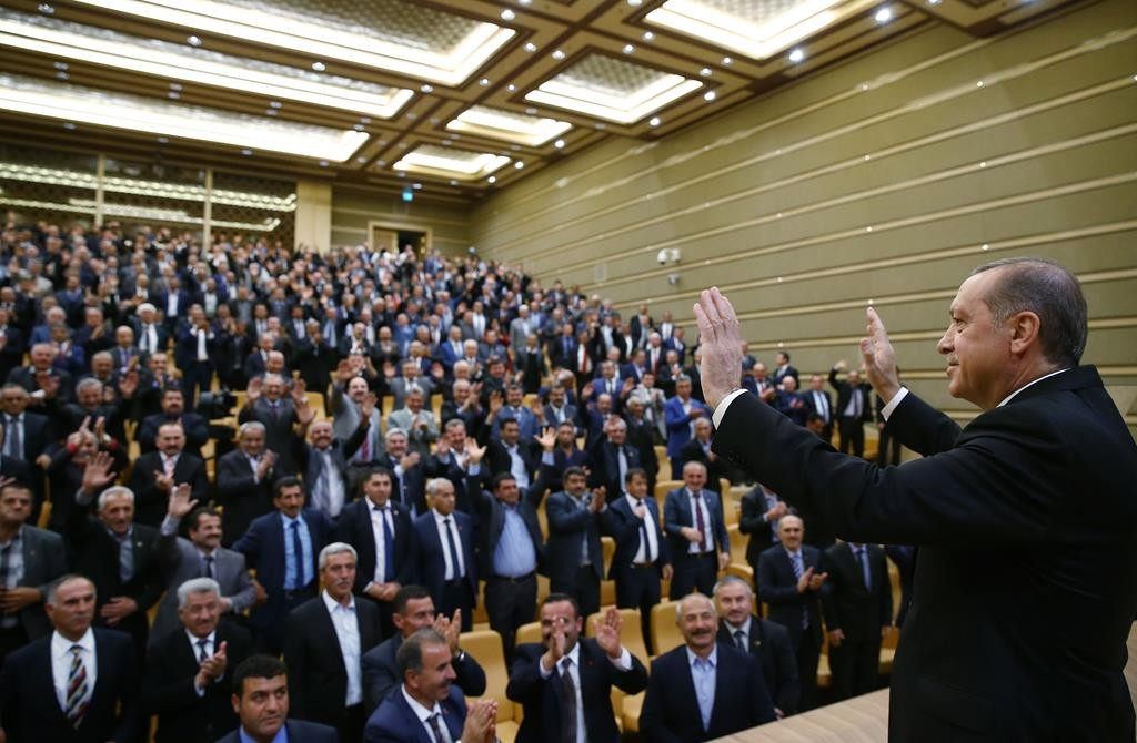 Presidential Press Service, Pool Turkish President Recep Tayyip Erdogan salutes as he addresses a meeting of local administrators at his palace in Ankara, Turkey, Thursday.  (AP Photo/Kayhan Ozer)