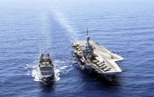France's flagship Charles de Gaulle aircraft carrier, right, steams with resupply ship La Meuse, in the Gulf of Sirte, off the Libyan coast, in this file photo. France has decided to deploy an aircraft carrier in the Persian Gulf to help fight Islamic State group in Iraq and Syria.  (AP Photo/Christophe Ena, File)