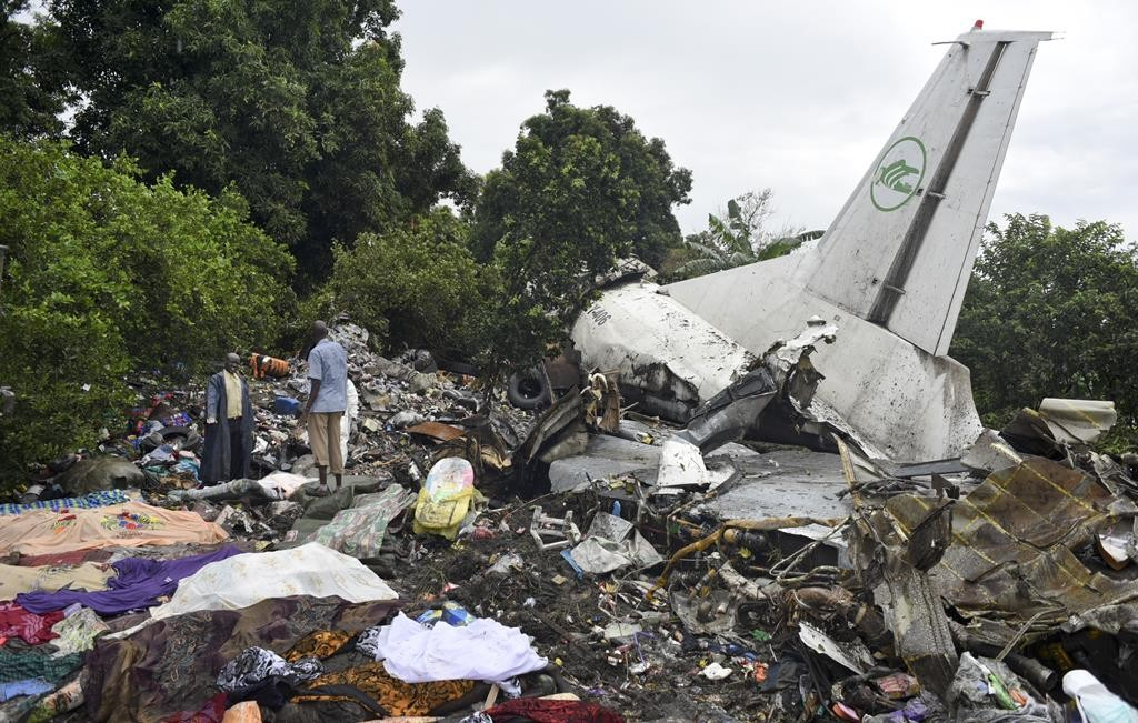 Responders pick through the wreckage of a cargo plane that crashed in the capital Juba, South Sudan, Wednesday. (AP Photo/Jason Patinkin)