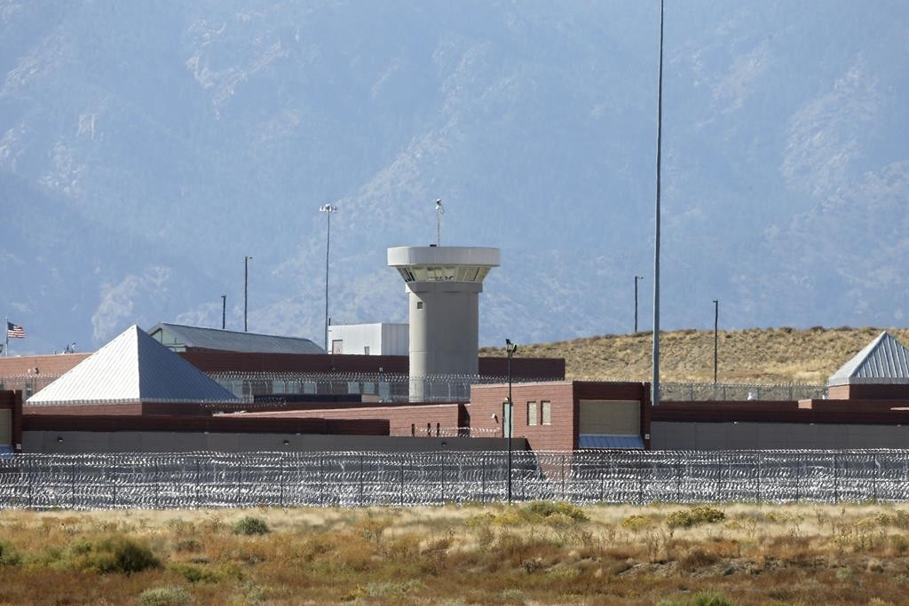 A guard tower looming over a federal prison complex that houses a Supermax facility outside Florence, in southern Colorado.  (AP Photo/Brennan Linsley,File)