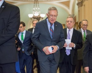 Senate Minority Leader Harry Reid (C), joined by Senate Minority Whip Richard Durbin of Ill. (2nd R) and Sen. Charles Schumer of N.Y. (R), leave their weekly policy conference on Capitol Hill in Washington, Tuesday.  (AP Photo/J. Scott Applewhite)