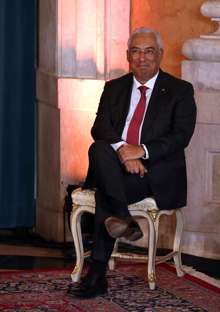 Antonio Costa, leader of the Portuguese Socialist Party, smiles moments before being sworn in as Portugal's new Prime Minister in a ceremony at the Ajuda palace in Lisbon, Thursday. (AP Photo/Armando Franca)