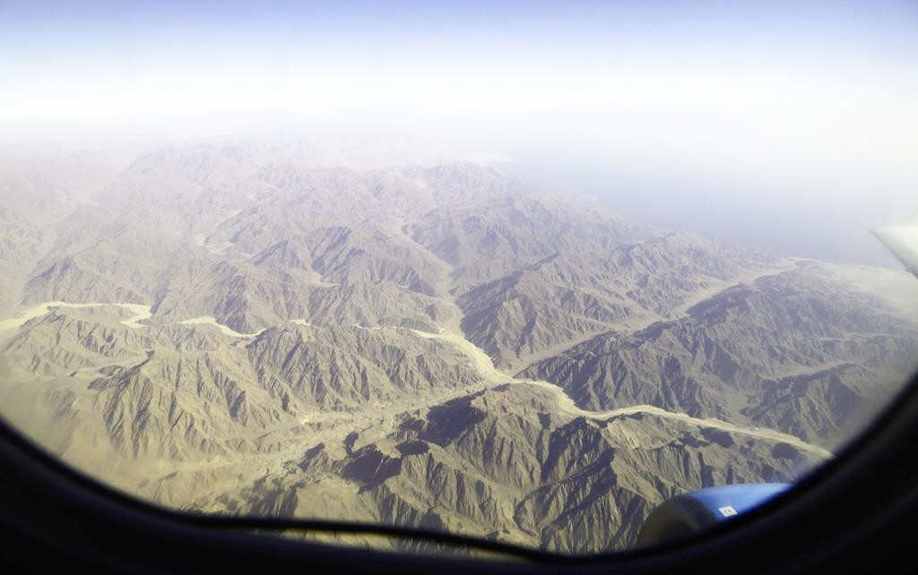 The mountains of south Sinai are viewed from the window during a flight to Cairo from Sharm el-Sheikh, Egypt, Monday.  (AP Photo/Thomas Hartwell)