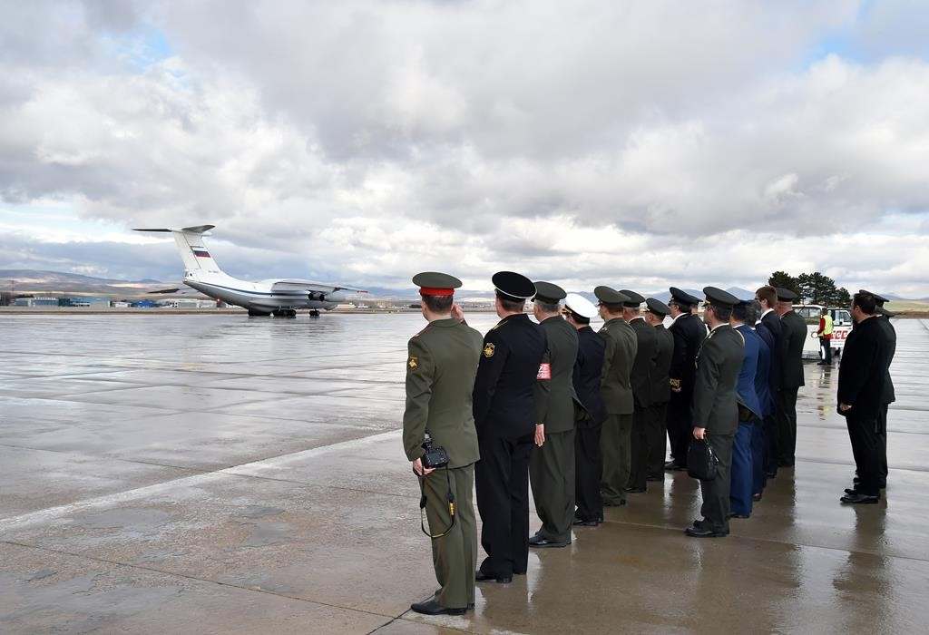 In this image provided by the Turkish military, a Russian Air Force transport plane takes off carrying the coffin of Russian pilot  Lt. Col. Oleg Peshkov at Esenboga Airport in Ankara, Turkey, Monday.  (Turkish Military via AP)
