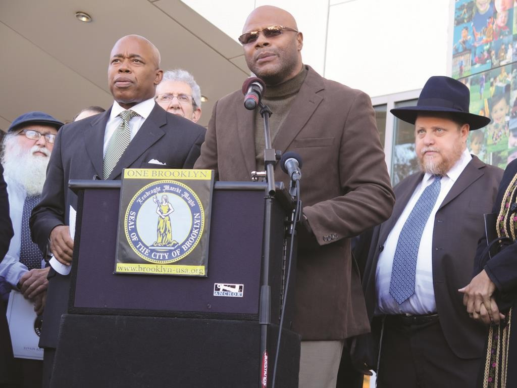 L-R: Borough President Eric Adams; Michael Miller of the JCRC (in back); activist Tony Herbert; Executive Director of the Crown Heights Jewish Community Council Chanina Sperlin, at a press conference in front of the Jewish Children's Museum in Crown Heights. (JDN)