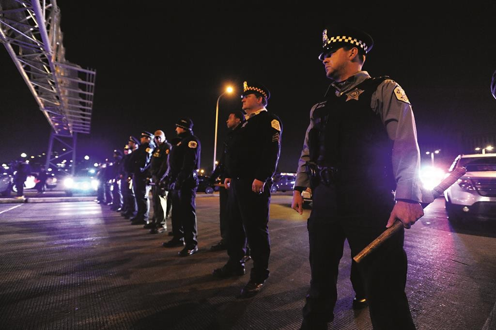 Chicago police form a line to prevent protestors from entering an expressway on Tuesday night, in Chicago.  (AP Photo/Paul Beaty)