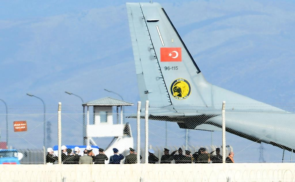 The coffin of the pilot killed when Turkey shot down a Russian jet is carried to a Turkish Air Force Cargo Aircraft, before being handed over to Russia, on the tarmac of the Hatay Airport in Hatay, Turkey, on Sunday.  (REUTERS/Stringer)