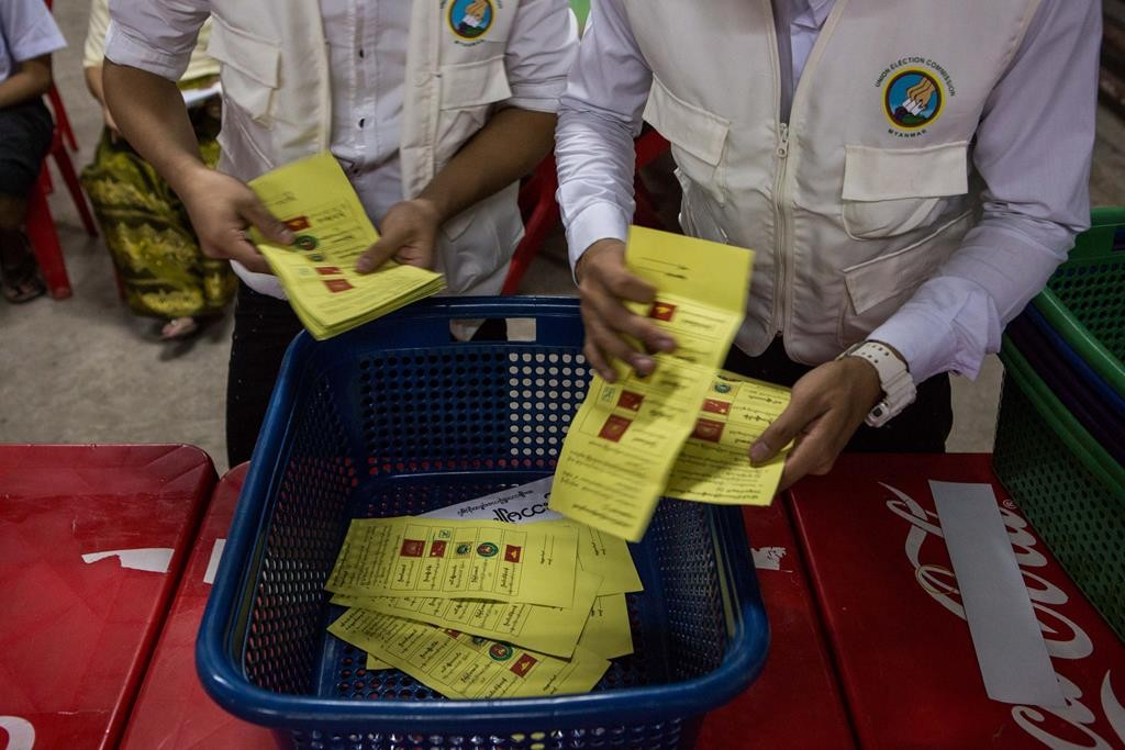Votes are counted in an unfinished building being used as a polling station in Yangon, Myanmar, on Sunday. (AP Photo/Amanda Mustard)