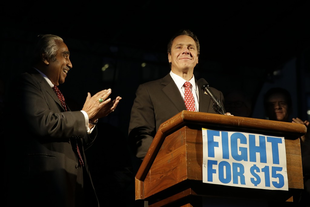 Rep. Charles Rangel (D-NY) listens as New York Gov. Andrew Cuomo speaks at a home care and healthcare workers rally in support of a $15 minimum wage, last week Tuesday in New York.  (AP Photo/Mary Altaffer)