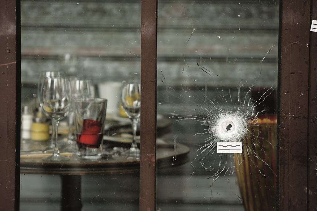 Bullets holes are seen through the glass door of a cafe after the terror attack on November 14, 2015 in Paris.  (Christopher Furlong/Getty Images)