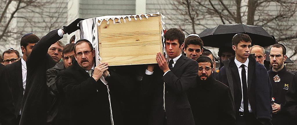 "At the levayah of Ezra Schwartz, Hy""d, in Sharon, Mass., Sunday, Nov. 22, 2015.  (Pat Greenhouse/The Boston Globe via AP)"