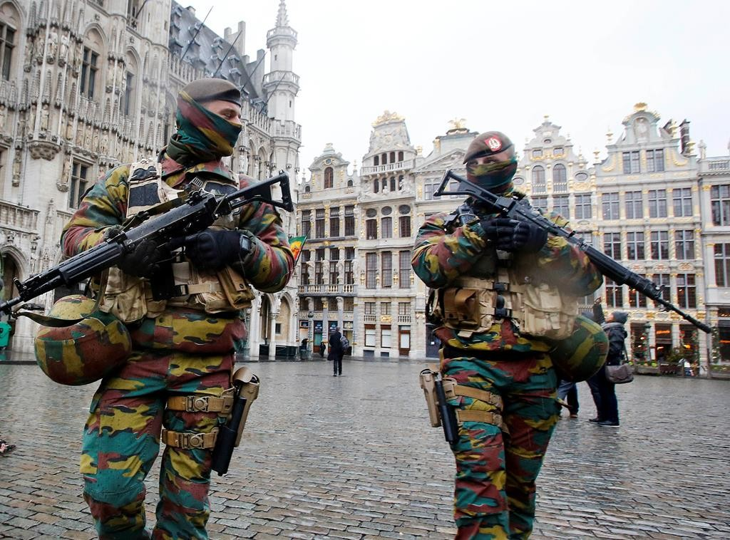 Belgium police officers patrol the Grand Place in central Brussels, Belgium, Tuesday. The lockdown has closed the capital's subways and schools. (AP Photo/Michael Probst)