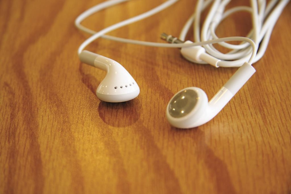 Hearing aids? Joshua Miller sold these earbuds as medically required tools. (Erik Escuro/Flickr)
