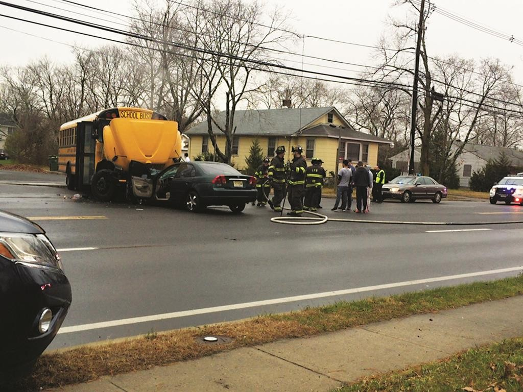A school bus and a car collided Sunday morning in Lakewood. There were no injuries. (TheLakewoodScoop.com)