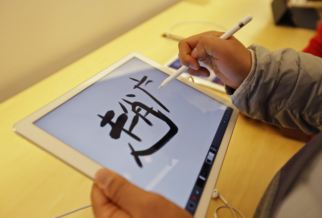 Using the Apple Pencil on the Apple iPad Pro. (AP Photo/Eric Risberg)