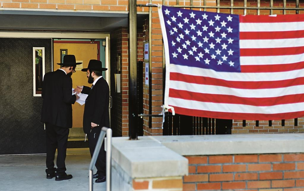 Two Jewish voters converse with each other outside of a polling location at in Clifton, NJ, on Tuesday. (Amy Newman/The Record via AP)