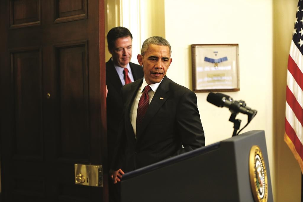 Martinez Monsivais President Barack Obama, followed by FBI Director James Comey, arrives in the Roosevelt Room of the White House in Washington, Wednesday, to brief the public on the nation's homeland security posture. (AP Photo/Pablo)