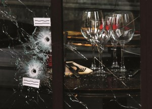 Bullet impacts are seen in the window of a restaurant window the day after the terrorist attack.  (REUTERS/Pascal Rossignol)