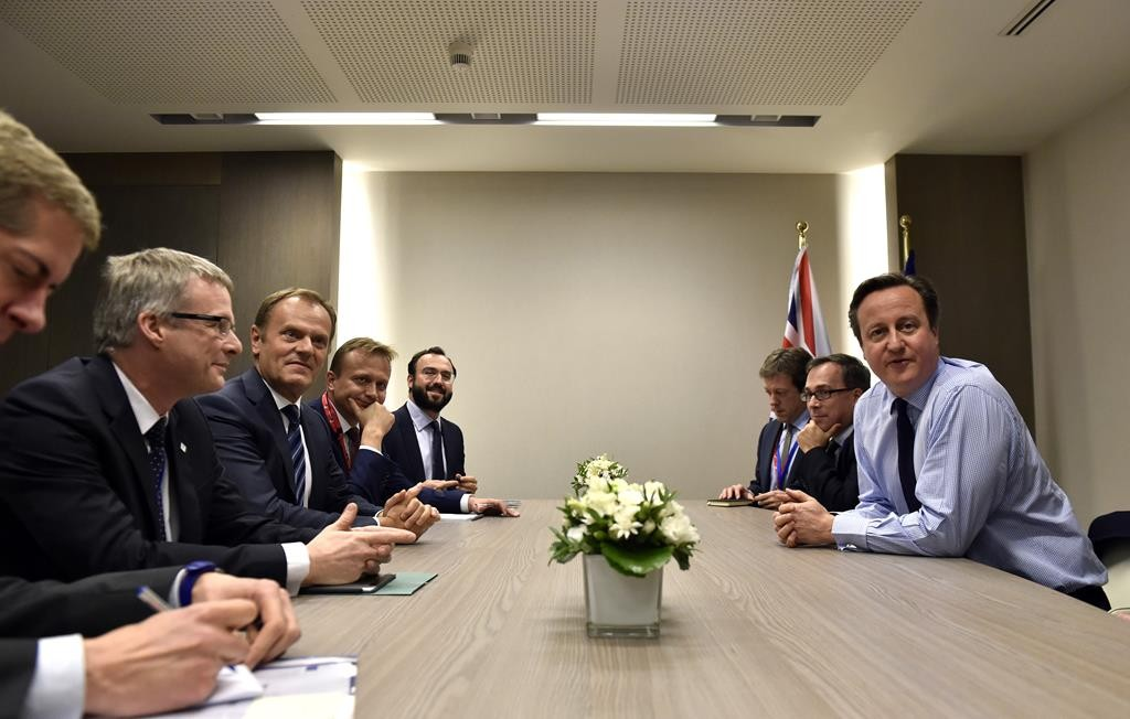 European Council President Donald Tusk (third L) meets with British Prime Minister David Cameron (R) on the sidelines of an EU-Turkey summit at the EU Council building in Brussels on Sunday. (Eric Vidal, Pool Photo via AP)