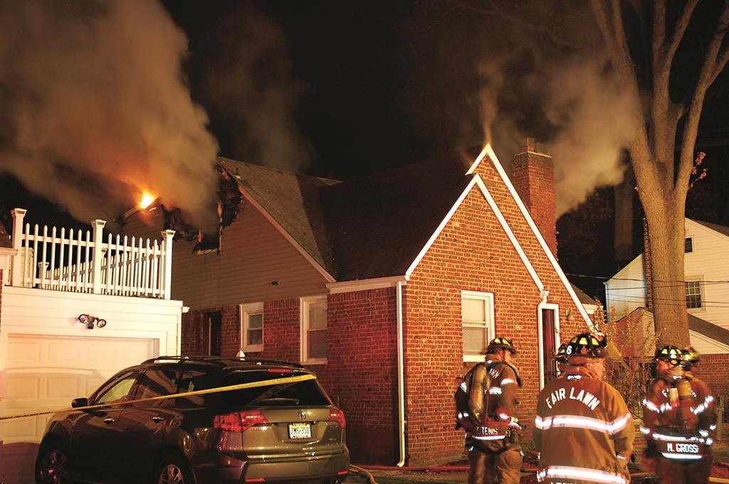 Firefighters battle a fire early Tuesday at an independent living facility that left two women dead and two injured in Fair Lawn, NJ. (AP Photo/Bill Tompkins)