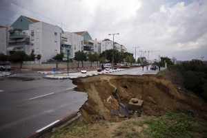 A partially collapsed street in Ashkelon after heavy rains and flooding on Monday. (Reuters/Amir Cohen )