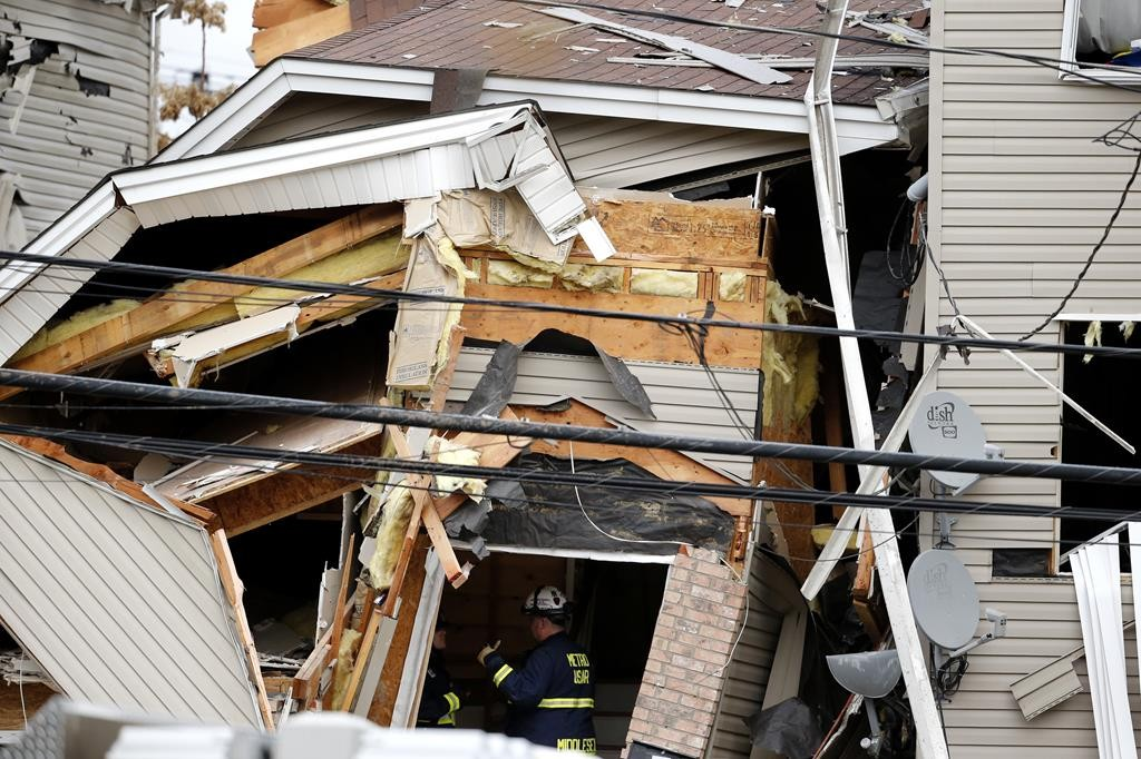 Officials on Wednesday investigate the inside of a house explosion in Elizabeth, N.J. (AP Photo/Julio Cortez)