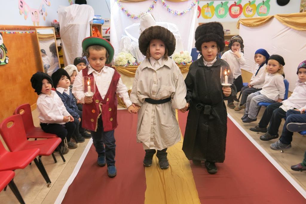 Children of the Munkatcher kindergarten reenact the wedding of Yitzchak and Rivkah, related in this week's parashah. (JDN)