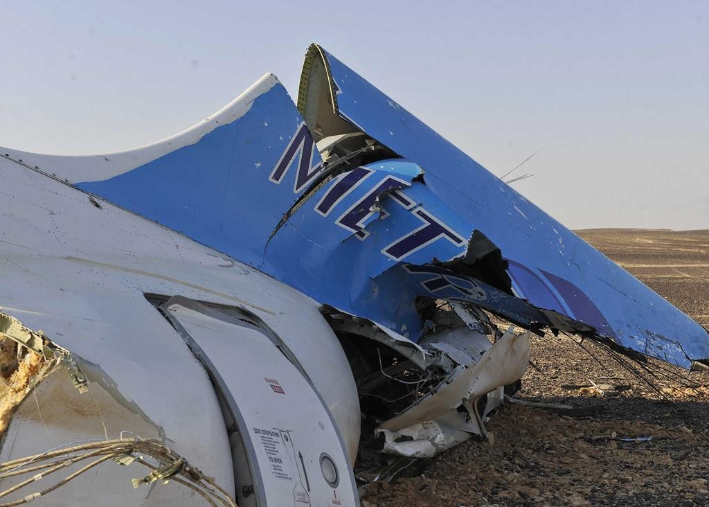 The remains of a crashed passenger jet in Hassana, Egypt, over the weekend. The Russian aircraft carrying 224 people crashed in a remote mountainous region in the Sinai Peninsula. (Suliman el-Oteify/Egyptian Prime Minister's Office via AP)